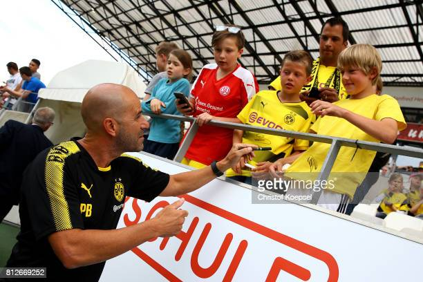 Head coach Peter Bosz of Dortmund0 gives autograpghs prior to the preseason friendly match between RotWeiss Essen and Borussia Dortmund at Stadion...