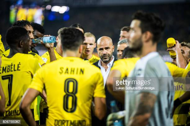 Head Coach Peter Bosz talks to his players prior to the penalty shootout of the DFL Supercup 2017 match between Borussia Dortmund and Bayern Muenchen...