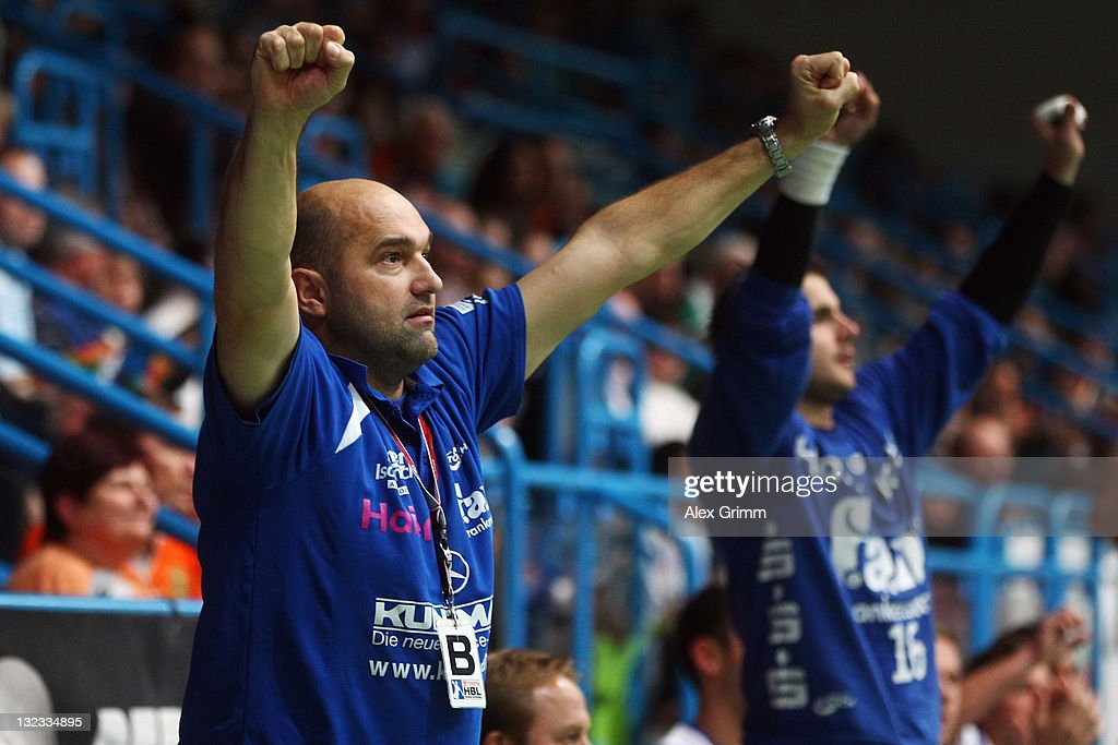 Head coach Peter David of Grosswallstadt celebrates during the Toyota Handball Bundesliga match between T VGrosswallstadt and MT Melsungen at f.a.n. frankenstolz arena on November 11, 2011 in Aschaffenburg, Germany.