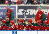 Head Coach Peter DeBoer and Assistant Coach Scott Stevens of the New Jersey Devils watch play from the behind the bench in the third period during...