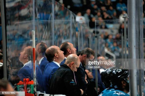 Head Coach Peter DeBoer and Assistant Coach Steve Spott look at the jumbotron during a NHL game against the Florida Panthers at SAP Center on...