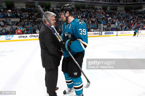 Head coach Peter DeBoer of the Edmonton Oilers talks with Logan Couture of the San Jose Sharks after defeating the San Jose Sharks in Game Six of the...