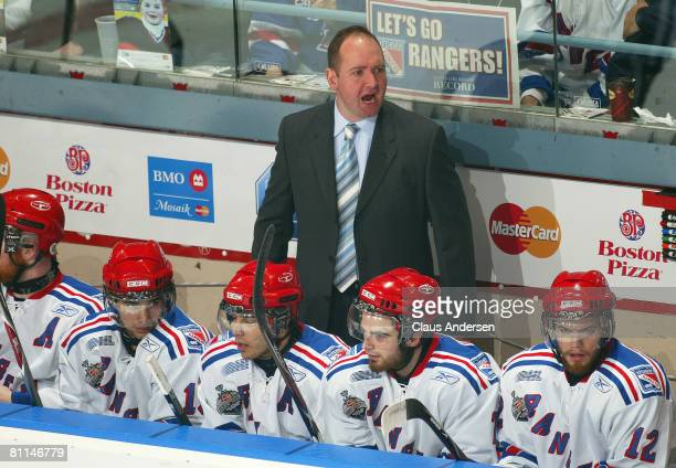 Head Coach Peter DeBoer of the Kitchener Rangers shouts out some orders to his players against the Spokane Chiefs in a Memorial Cup round robin game...