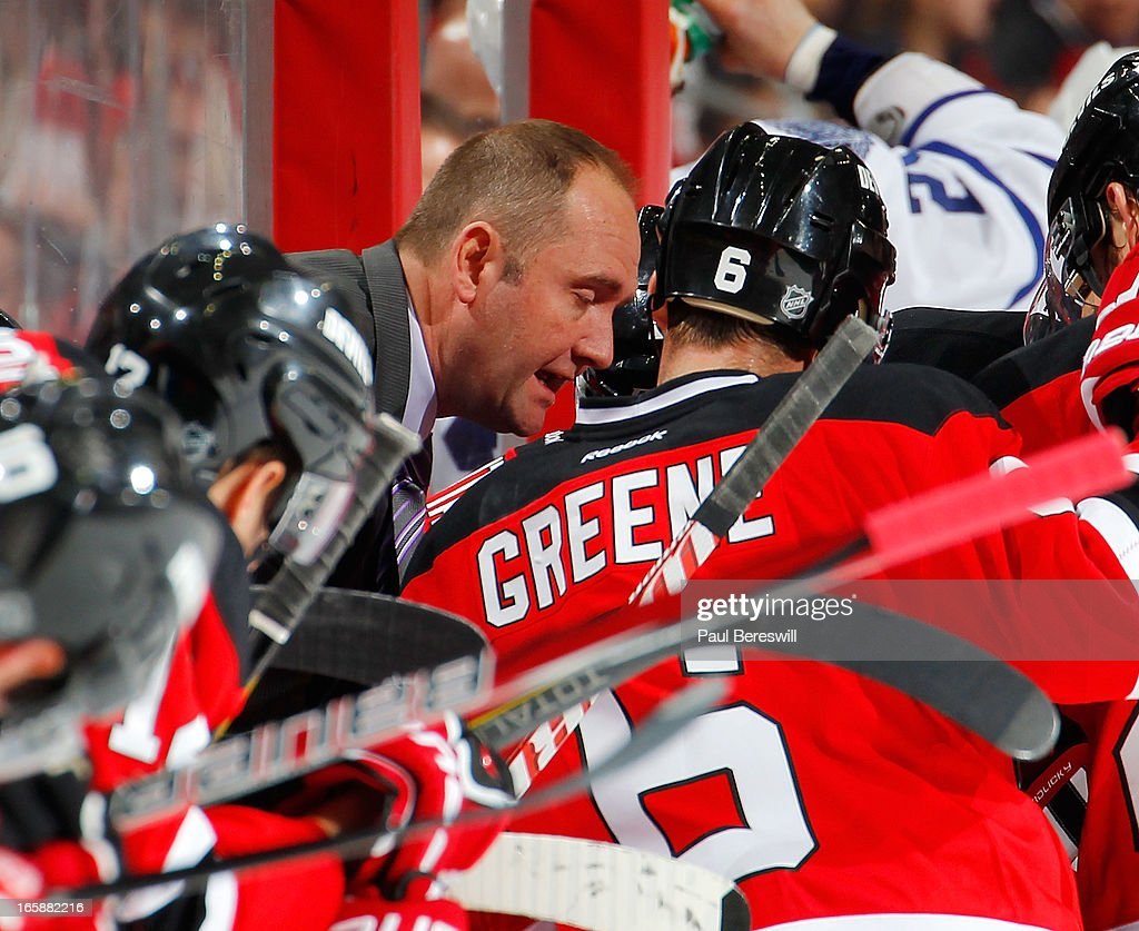 Head coach Peter DeBoer of the New Jersey Devils talks to his team during a timeout with less than a minute left in an NHL hockey game against the Toronto Maple Leafs at Prudential Center on April 6, 2013 in Newark, New Jersey. The Leafs won 2-1.