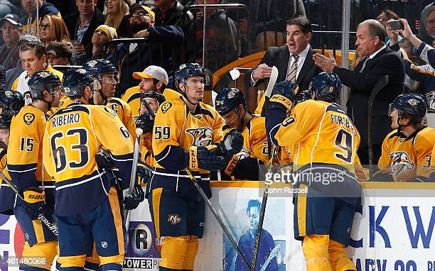 Head coach Peter Laviolette and assistant coach Kevin McCarthy of the Nashville Predators call a play during a timeout against the Dallas Stars at...