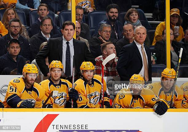 Head coach Peter Laviolette and assistant Kevin McCarthy of the Nashville Predators coach against the Colorado Avalanche in a 43 win for their 100th...