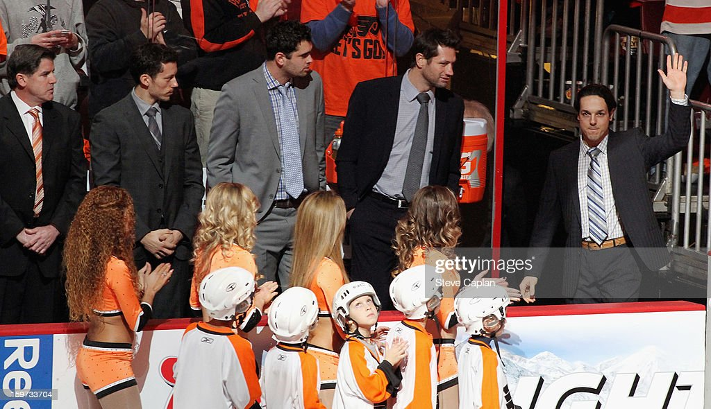 Head Coach Peter Laviolette, Bruno Gervais #27, Tom Sestito #32, Jody Shelley #45, and Danny Briere #48 of the Philadelphia Flyers are introduced to the crowd during pregame ceremonies prior to playing the Pittsburgh Penguins on January 19, 2013 at the Wells Fargo Center in Philadelphia, Pennsylvania.