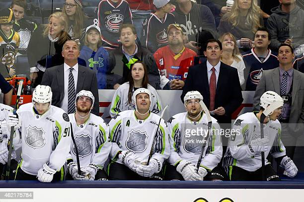 Head coach Peter Laviolette of the Nashville Predators and Team Toews looks on against Team Foligno during the 2015 Honda NHL AllStar Game at...