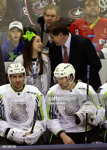 Head coach Peter Laviolette of the Nashville Predators and Team Toews laughs with his daughter during the 2015 Honda NHL AllStar Game at Nationwide...