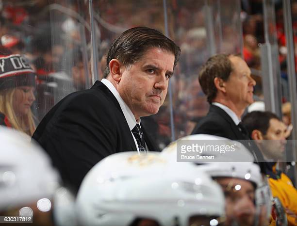 Head coach Peter Laviolette of the Nashville Predators handles bench duties during the game against the New Jersey Devils at the Prudential Center on...