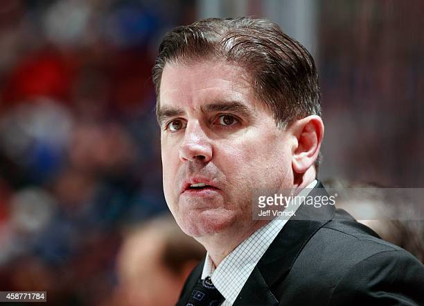 Head coach Peter Laviolette of the Nashville Predators looks on from the bench during their NHL game against the Vancouver Canucks at Rogers Arena...