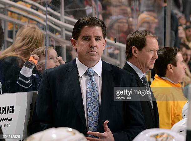 Head coach Peter Laviolette of the Nashville Predators looks on from the bench during first period action against the Arizona Coyotes at Gila River...