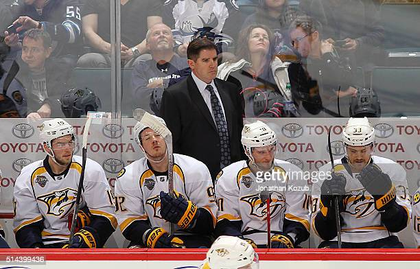 Head Coach Peter Laviolette of the Nashville Predators looks on from the bench during third period action against the Winnipeg Jets at the MTS Centre...