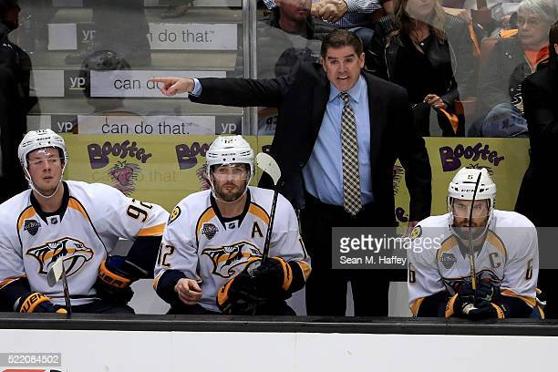 Head coach Peter Laviolette of the Nashville Predators motions to officals during the third period against the Anaheim Ducks in Game Two of the...