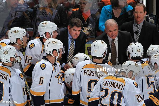 Head coach Peter Laviolette of the Nashville Predators talks to his players before resuming play against the Anaheim Ducks during Game Two of the...