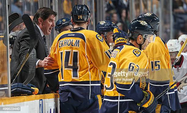 Head coach Peter Laviolette of the Nashville Predators talks with Craig Smith and Mattias Ekholm during a timeout against the Arizona Coyotes during...