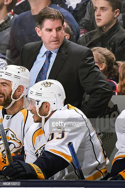 Head Coach Peter Laviolette of the Nashville Predators watches his team play against the Columbus Blue Jackets on December 22 2014 at Nationwide...