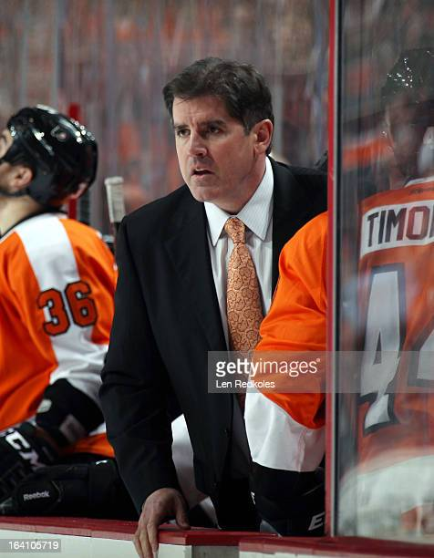 Head coach Peter Laviolette of the Philadelphia Flyers looks on during a stoppage in play against the New Jersey Devils on March 15 2013 at the Wells...