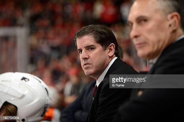Head coach Peter Laviolette of the Philadelphia Flyers watches the game against against the Washington Capitals at the Verizon Center on February 1...