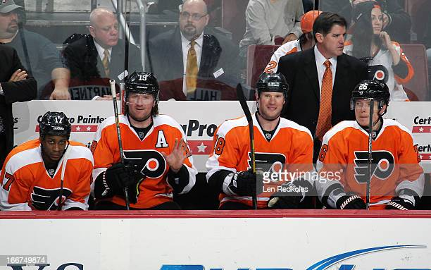 Head Coach Peter Laviolette Wayne Simmonds Scott Hartnell Adam Hall and Ruslan Fedotenko of the Philadelphia Flyers watch the play from the bench...
