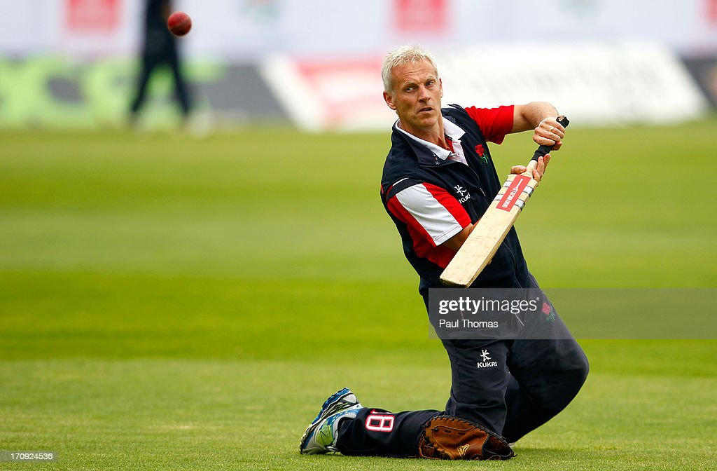 Head coach Peter Moores of Lancashire hits the ball during the warm up before day one of the LV County Championship Division Two match between Lancashire and Northamptonshire at Old Trafford on June 20, 2013 in Manchester, England.