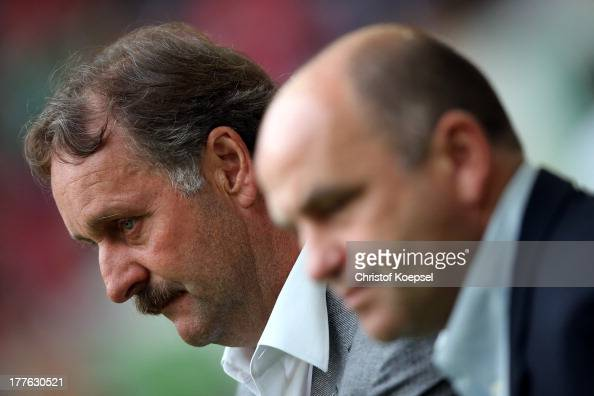 Head coach Peter Neururer and manager Christian Hochstaetter of Bochum look on prior to the Second Bundesliga match between Fortuna Duesseldorf and...
