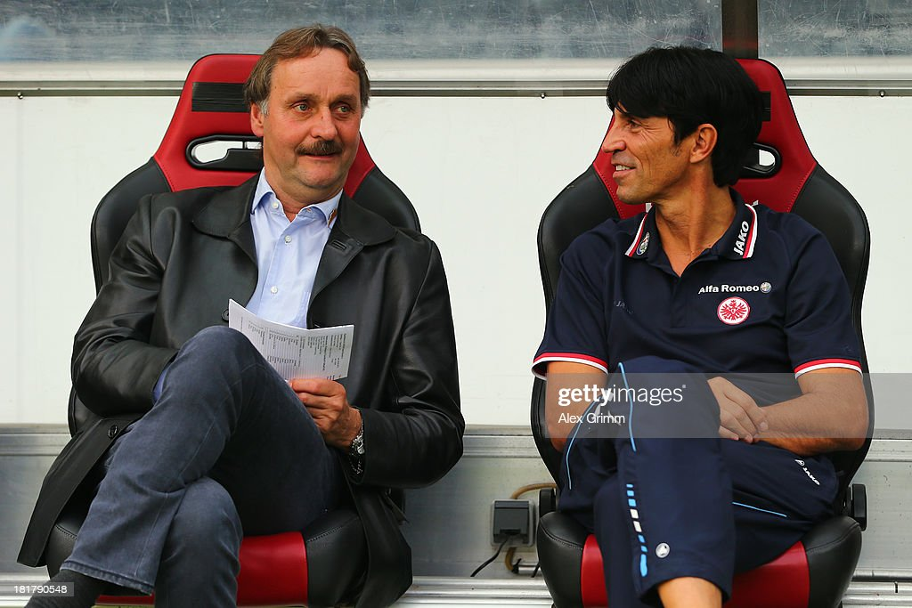 Head coach Peter Neururer of Bochum (L) chats with manager Bruno Huebner of Frankfurt prior to the DFB Cup second round match between Eintracht Frankfurt and VfL Bochum at Commerzbank-Arena on September 25, 2013 in Frankfurt am Main, Germany.