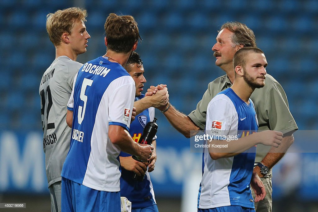 Head coach <a gi-track='captionPersonalityLinkClicked' href=/galleries/search?phrase=Peter+Neururer&family=editorial&specificpeople=214567 ng-click='$event.stopPropagation()'>Peter Neururer</a> of Bochum (R) congratulates goalie Felix Dornebusch of Bochum (L) saving a penalty after the pre-season friendly match between VfL Bochum and FC Schalke 04 at Rewirpower Stadium on August 5, 2014 in Bochum, Germany. The match between Bochum and Schalke ended 1-1.