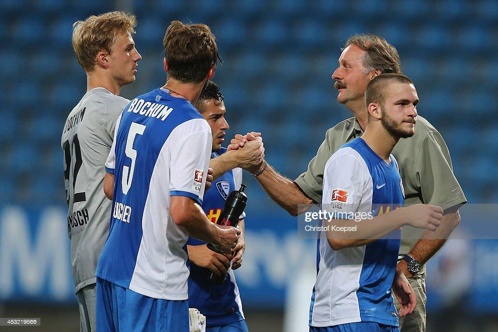 Head coach Peter Neururer of Bochum (R) congratulates goalie Felix Dornebusch of Bochum (L) saving a penalty after the pre-season friendly match between VfL Bochum and FC Schalke 04 at Rewirpower Stadium on August 5, 2014 in Bochum, Germany. The match between Bochum and Schalke ended 1-1.