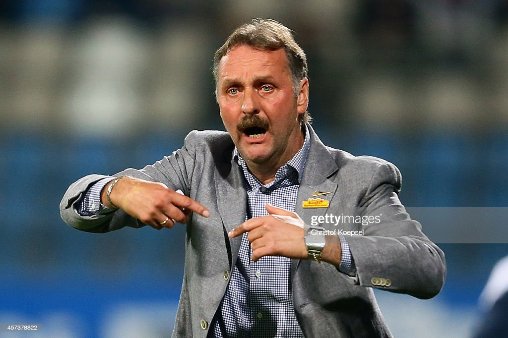 Head coach Peter Neururer of Bochum issues instructions during the Second Bundesliga match between VfL Bochum and Darmstadt 98 at Rewirpower Stadion...