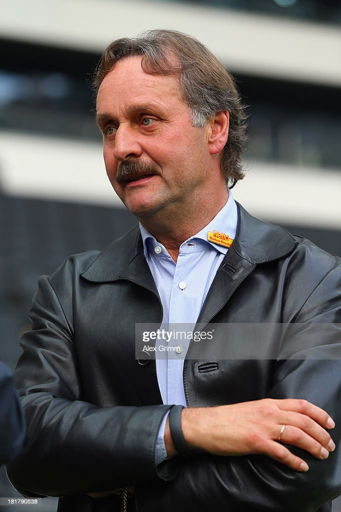 Head coach Peter Neururer of Bochum looks on prior to the DFB Cup second round match between Eintracht Frankfurt and VfL Bochum at Commerzbank-Arena on September 25, 2013 in Frankfurt am Main, Germany.