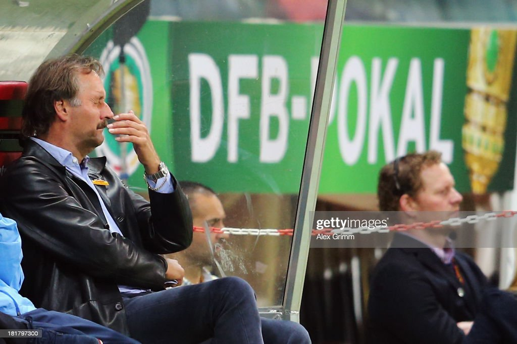 Head coach <a gi-track='captionPersonalityLinkClicked' href=/galleries/search?phrase=Peter+Neururer&family=editorial&specificpeople=214567 ng-click='$event.stopPropagation()'>Peter Neururer</a> of Bochum reacts during the DFB Cup second round match between Eintracht Frankfurt and VfL Bochum at Commerzbank-Arena on September 25, 2013 in Frankfurt am Main, Germany.