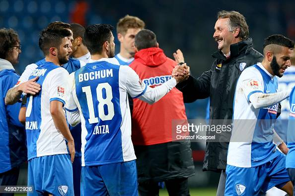 Head coach Peter Neururer of Bochum shake hands with Danny Latza after the Second Bundesliga match between VfL Bochum and VfR Aalen at Rewirpower...
