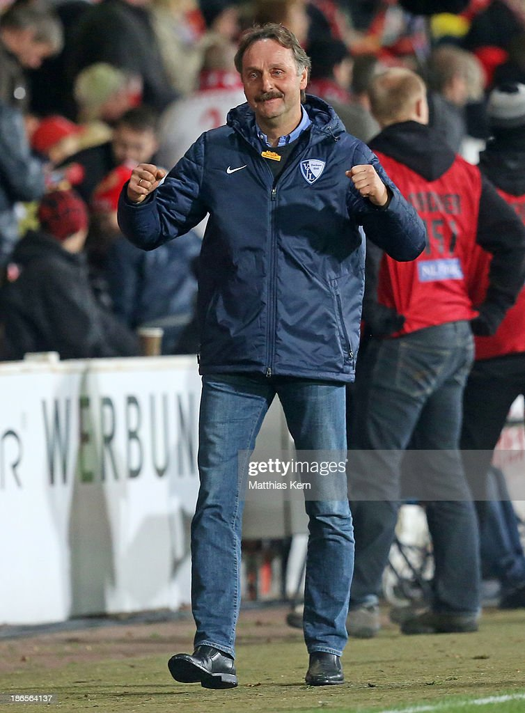 Head coach Peter Neururer of Bochum shows his delight after winning the Second Bundesliga match between FC Energie Cottbus and VFL Bochum at Stadion...
