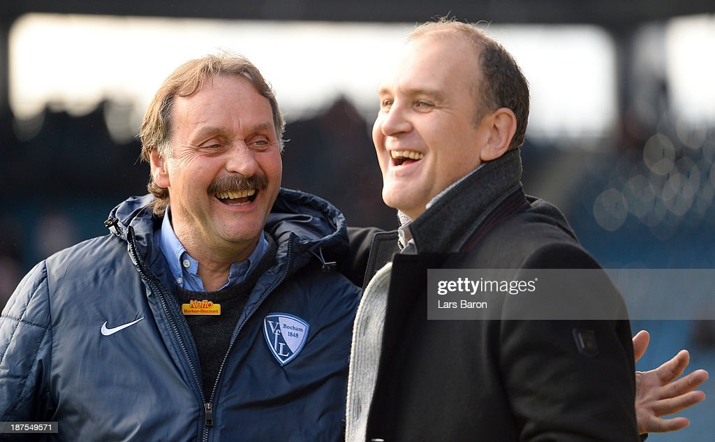 Head coach Peter Neururer of Koeln smiles with Joerg Schmadtke manager of Koeln prior to the Second Bundesliga match between VfL Bochum and 1 FC...