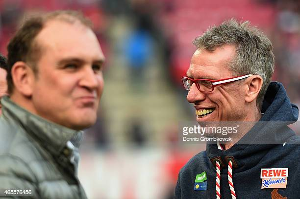 Head coach Peter Stoeger and manager Joerg Schmadtke of Koeln look on prior to the Bundesliga match between 1 FC Koeln and Eintracht Frankfurt at...