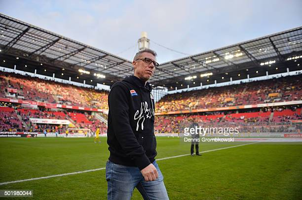 Head coach Peter Stoeger of 1 FC Koeln looks on prior to kickoff during the Bundesliga match between 1 FC Koeln and Borussia Dortmund at...