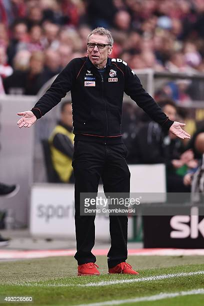 Head coach Peter Stoeger of 1 FC Koeln reacts during the Bundesliga match between 1 FC Koeln and Hannover 96 at RheinEnergieStadion on October 18...