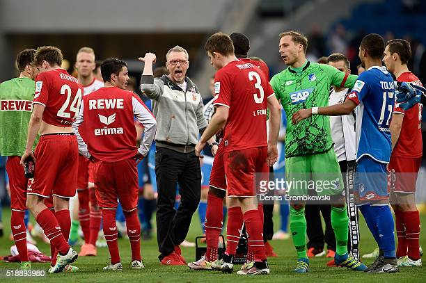 Head coach Peter Stoeger of 1 FC Koeln shouts back Dominique Heintz after the Bundesliga match between 1899 Hoffenheim and 1 FC Koeln at Wirsol...