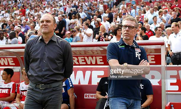 Head Coach Peter Stoeger of Cologne and Joerg Schmadtke look on prior the Bundesliga match between 1 FC Koeln and VfL Wolfsburg at...