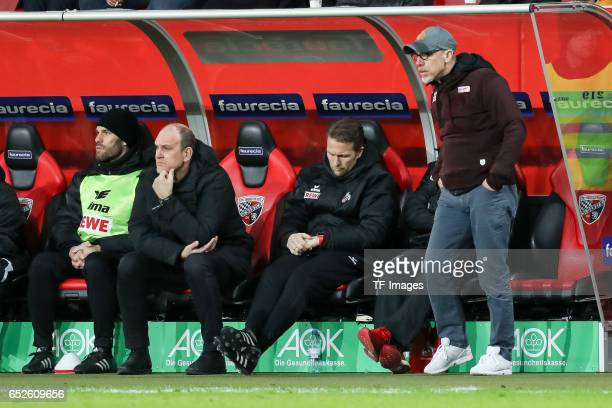 Head coach Peter Stoeger of Cologne CEO Jörg Schmadtke of Cologne looks on en during the Bundesliga match between FC Ingolstadt 04 and 1 FC Koeln at...