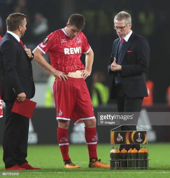 Head coach Peter Stoeger of Koeln and Dominique Heintz looks on during the UEFA Europa League group H match between 1 FC Koeln and Crvena Zvezda at...