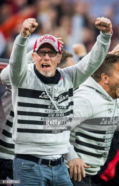 Head Coach Peter Stoeger of Koeln celebrates his teams second goal during the Bundesliga match between 1 FC Koeln and Werder Bremen at...