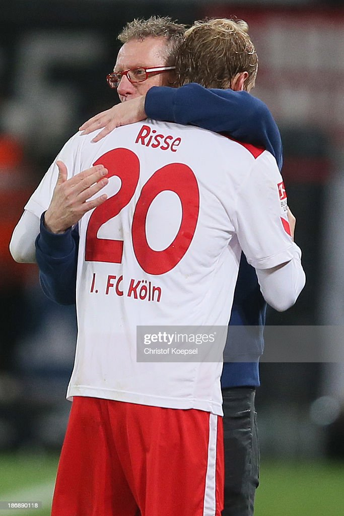 Head coach Peter Stoeger of Koeln (R) embraces Marcel Risse of Koeln during the Second Bundesliga match between 1. FC Koeln and 1. FC Union Berlin at RheinEnergieStadion on November 4, 2013 in Cologne, Germany.
