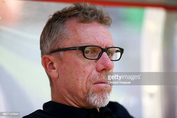 Head coach Peter Stoeger of Koeln looks on prior to the Colonia Cup 2015 match between 1 FC Koeln and FC Valencia at RheinEnergieStadion on August 2...