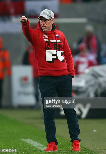 Head coach Peter Stoeger of Koeln reacts during the Bundesliga match between 1 FC Koeln and Eintracht Frankfurt at RheinEnergieStadion on February 13...
