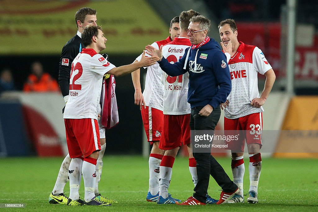 Head coach Peter Stoeger (2nd R) of Koeln shake hands with Daniel Halfar (2nd L) after the Second Bundesliga match between 1. FC Koeln and 1. FC Union Berlin at RheinEnergieStadion on November 4, 2013 in Cologne, Germany. The match between Koeln and Union Berlin ended 4-0.