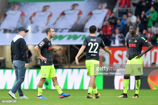Head coach Peter Stoeger of Koeln walks to his players Matthias Lehmann Jorge Mere and Sehrou Guirassy after the Bundesliga match between FC Augsburg...