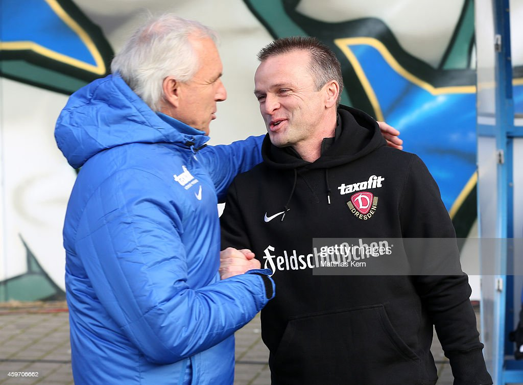 Head coach Peter Vollmann of Rostock and head coach Stefan Boeger of Dresden look on prior to the third league match between FC Hansa Rostock and SG...