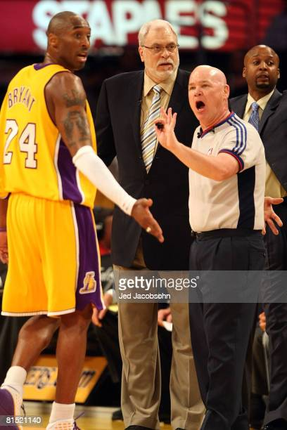 Head coach Phil Jackson and Kobe Bryant of the Los Angeles Lakers argue a call with referee Joe Crawford while taking on the Boston Celtics in Game...